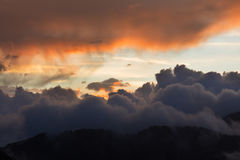 Dramatic cloudscape clouds sunset over mountains Royalty Free Stock Photos