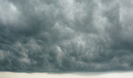 Dramatic Cloudscape - Dark Cloudy Sky forming tropical rainfall stock photography