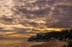 Dramatic cloudscape over beach at sunset. Stock Photos