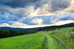 Dramatic cloudscape over rural road Royalty Free Stock Photography