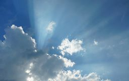 Dramatic Cloudscape - Rays of sun light through cloudy sky stock image