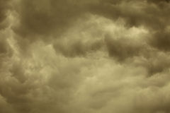 Dramatic cloudscape. Stormy clouds on the sky. Dramatic cloudscape. Dark stormy clouds covering the sky as nature background. Meteorology. Sepia tone Stock Photo