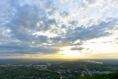 Dramatic Cloudscape with sunset over town Royalty Free Stock Photo