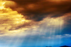 Dramatic Cloudscape  in sunset. Sunrays bursting through clouds in sunset Stock Images