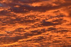 Dramatic cloudscape under sunset light. Spectacular clouds layer beautifully colored in red by sunset light stock photo