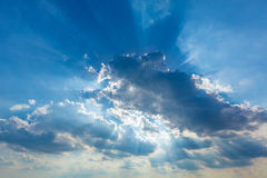 Dramatic cloudy sky clouds with real sun beams Stock Photography
