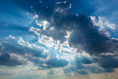 Dramatic cloudy sky clouds with real sun beams Stock Photo
