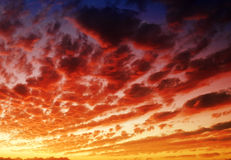 Dramatic cloudy sky at dusk. Sunset creating dramatic lighting effects in a cloudy sky Royalty Free Stock Image