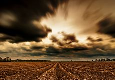 A dramatic cloudy sky - photo taken in longtimeexposure. Setting stock photo