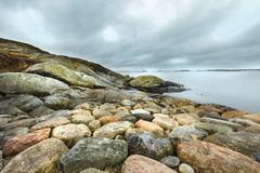 Dramatic cloudy sky with rocks. In foreground royalty free stock image