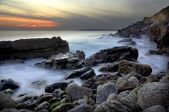 Dramatic Coastline. With the ocean in motion in the evening Stock Image