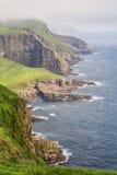 Dramatic coastline on Faroe islands. Stock Photos