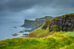 Dunluce Castle ruins on Causeway Coast, Antrim, Northern Ireland. Dramatic coastline scenery on a stormy day, Northern Ireland Royalty Free Stock Photos