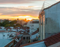Dramatic color sunset rooftops of Madrid.  Glowing fiery orange Madrid sky & rooftops at sunset. Royalty Free Stock Photography