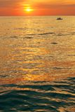Dramatic colorful sea sunset with sun setting on water stock photo