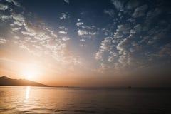 Dramatic colorful seascape. Sun, evening sky Stock Photo