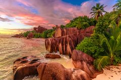 Anse Source d`Argent at dusk. Dramatic colorful sky at twilight at scenic Anse Source d`Argent Beach in Seychelles, La Digue. Aerial view of amazing landscape stock image