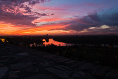 Dramatic colorful sunset over confluence of Danube and Sava river in Belgrade Stock Photo