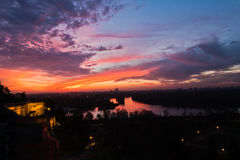 Dramatic colorful sunset over confluence of Danube and Sava river in Belgrade Royalty Free Stock Images