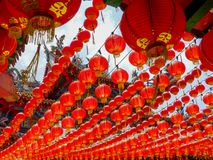 Chinese temple from beneath a canopy of red chinese lanterns stock photos