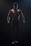 Dramatic concept photo of confident young fitness man Royalty Free Stock Photo