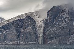 Dramatic Crevice in a Coastal Cliff. On Sam Ford Fjord on Baffin Island in Nunavut, Canada Royalty Free Stock Images