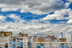 Dramatic cumulonimbus clouds on blue sky over cityscape Stock Photography