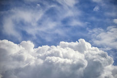 Dramatic cumulus clouds with high level cirrocumulus clouds for Royalty Free Stock Images