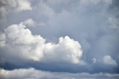Dramatic cumulus clouds with high level cirrocumulus clouds for Royalty Free Stock Photography