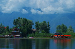 Dramatic Dal lake landscape. A beautiful and rich royal houseboats standing in lake in Kashmir Royalty Free Stock Image