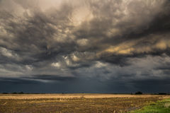 Dramatic dark clouds Stock Images