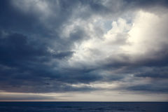 Dramatic dark cloudy sky over se. A, natural photo background Royalty Free Stock Photography