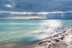Dramatic dark cloudy sky over sea Stock Photography