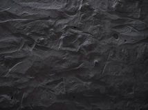 Dramatic raw dark grey concrete wall texture background. Royalty Free Stock Images