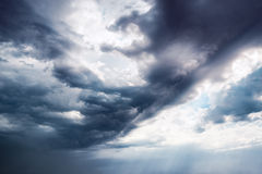 Dramatic dark sky with sun rays Stock Images