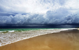 Dramatic dark storm clouds coming over sea Stock Images