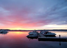 Dramatic dawn on St. Lawrence River, USA. Dramatic dawn over marina on St. Lawrence River, USA royalty free stock photography