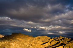 Dramatic Death Valley Sunrise. Dramatic clouds at sunrise in Death Valley National Park, California Stock Photo