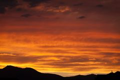 A dramatic and deep orange sunset in Salt Lake City. royalty free stock photo