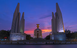 Dramatic democracy Monument. Democracy Monument and dramatic sunset sky. Thailand stock photos
