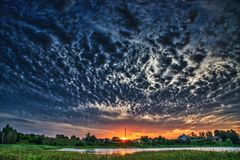 Dramatic dense cloudy sky near lake Stock Photo