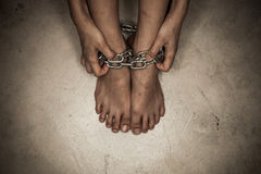 Dramatic detail of the chained feets Stock Photography
