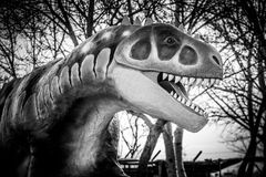 Dramatic dinosaur sculpture in black and white Stock Image