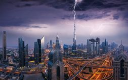 Dramatic Dubai view of downtown with lightning royalty free stock photo