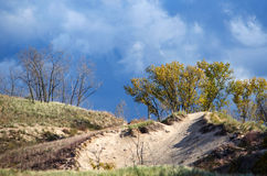 Dramatic dunes and sky Stock Images
