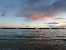 Dramatic Dusk on Magic Island Beach lagoon over the ocean with b Royalty Free Stock Images