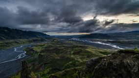 Dramatic evening over volcanic mountains in Iceland. Time lapse. Dramatic evening with gray clouds moving over sky in Iceland volcanic mountains and river stock video