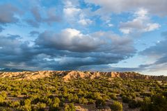 Dramatic sky and clouds over the desert landscape along the pilgrimage route to Chimayo, New Mexico royalty free stock photo
