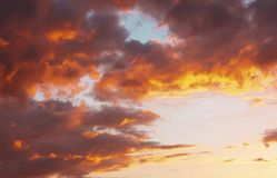 Dramatic sky with clouds in sunset. Dramatic evening sky with contrasting dark and bright low clouds Stock Photos