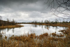 Dramatic fall landscape. With lake Stock Photos